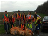 Junior Leaders pick up trash on Bueche Road during their Trash Bash event