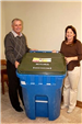 Mary Delapasse and Parish President Riley pose with new recycle carts