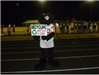 High School Mascot poses with Recycle Cans and Bottles sign